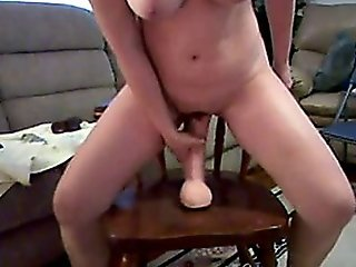 Horny Wife Sits On Huge Dildo