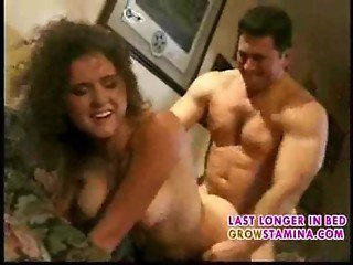 Curly chick fucking on ugly sofa