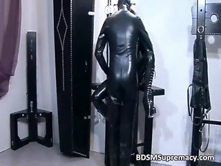 Ginger whore in rubber cloth gets cunt