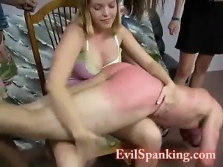 Girlfriends spanking a male whore