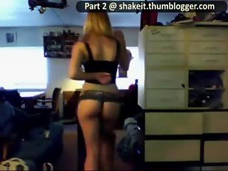girl strips in a tiny black and red thong while dancing