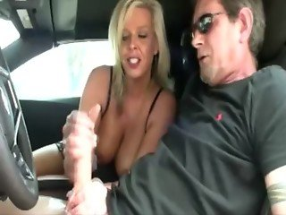 Lucky guy gets a tugjob in his car from horny blond