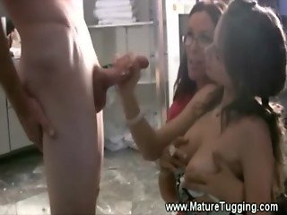 Slutty milf and daughter giving tugjob