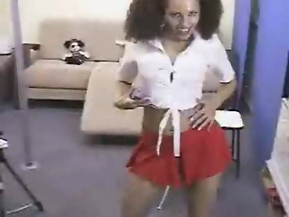 Schoolgirl does striptease and masturbates