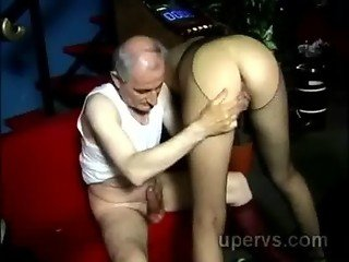 Hot young blondie in sexy fishnets orally pleases grandpa