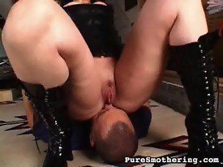 female goth in latex facetting a guy