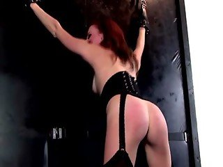 Miss Crash punishes Hollis Ireland with her whip