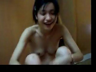 Young asian teen undressing