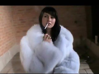 Slut in Fur Coat and Boots Smokes