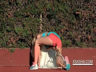 Slim Sasha working her horny cunt on the tennis field