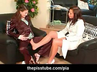 rubbing her silky clothed pussy on her feet