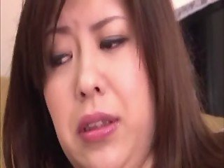 Oriental MILF plays with anal beads