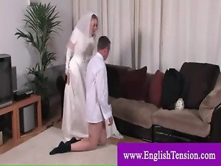 Naughty bride whipping her man
