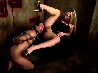 Harmony pushing pussy into slaves mouth
