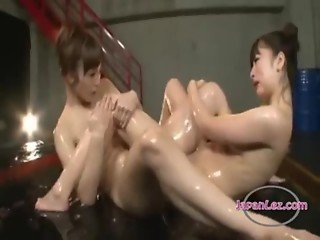 2 Asian Girls Lotion On Bodies Kissing Fingering Each Other On The Wrestling Mat