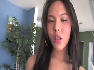 Asian transsexual gives a striptease