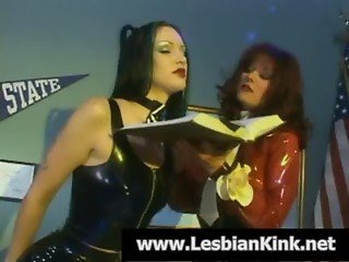 Lesbians in latex spanking their hot round asses