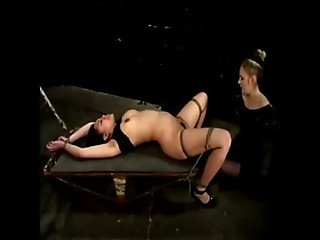 Dominatrix sits on a lovely asian slaves face