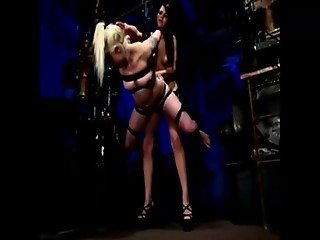 Dominatrix fucks slave with a fake dick