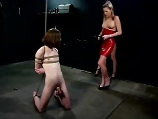 Dominatrix gets mean at her dungeon
