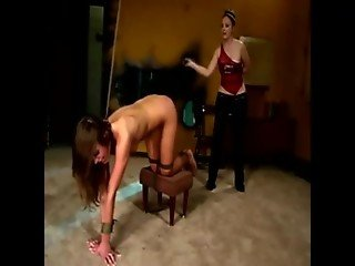 She gets bent over by her domina who brought her whip