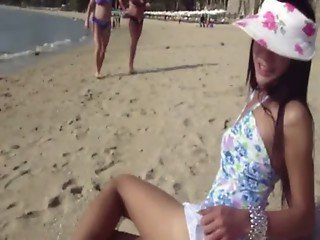 Ladyboy in a cute dress walking by the beach