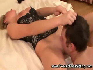 On her knees she shoves her pussy in his face