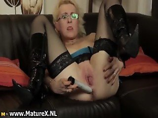Horny blond housewife with glasses