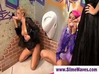 Cum drenched ladies at a gloryhole