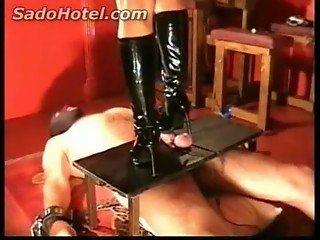 Slave gets his cock and balls trampled (stand on) by horny mistress