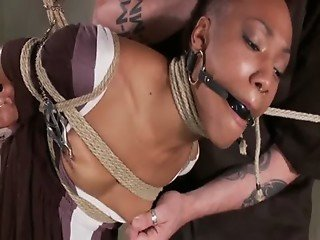 Tied up black submissive pleasing master