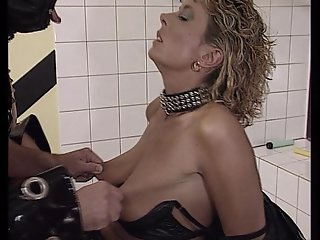 Biker couple enjoys leather costumes and fucking in the bathroom. (Clip)