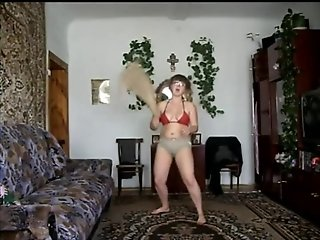 Chubby Russian girl strips in parents living room.