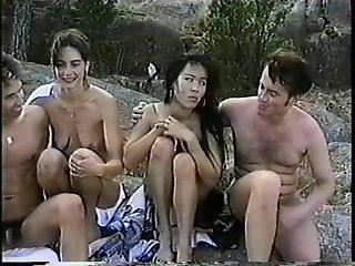 Young dudes shares two pussy by the lake - Classic X Collection