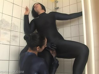 Two girls in catsuit in the shower