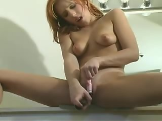 Young girl shaved pussy masterbating