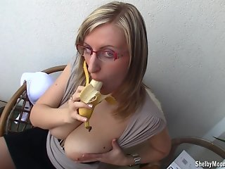Shelby licking banana
