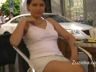 Sexy girl in miniskirt and no panties in a cafe
