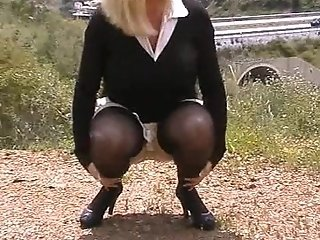 Housewife In Stockings On A Busy Road