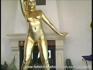 Golden painted Reneta luxuries posing