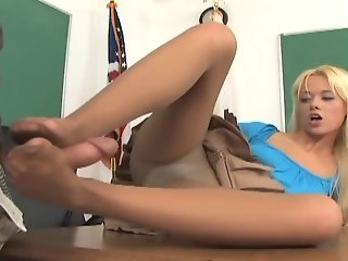 Blonde babe in pantyhose gives a messy footjob