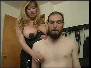 Mistress Cristian fooling around with her slaves nipples