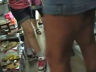 Upskirt in shoestore no panties and piercing