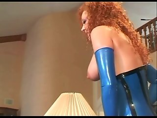 Redhead anal sex in stockings and a latex corset