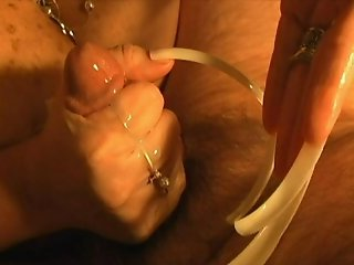 VERY long nails jerking a cock onto very long nails.
