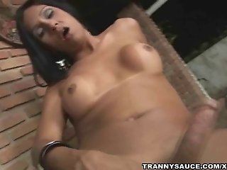 Foxy brunette tranny vixen playing with her hard cock