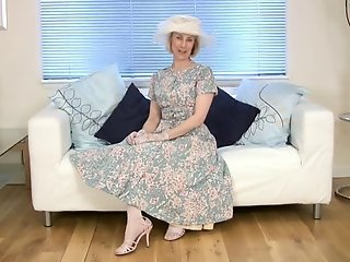 Mature housewife fucks a cucumber