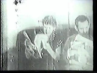 Vintage clip of southern belle with big tits sucking husband's big cock on sofa