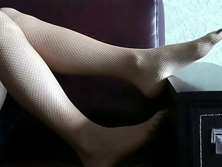 Foot tease in fishnet