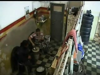 Babe gets fucked in a tire shop and it's all on a hidden cam